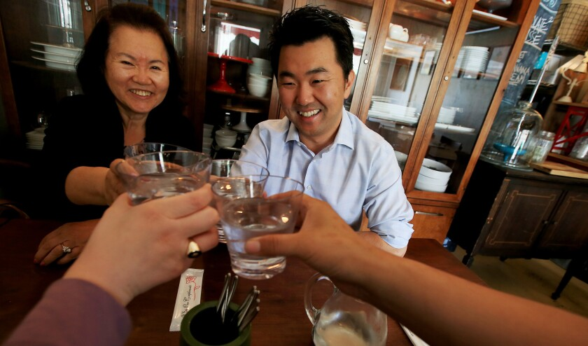 L.A. City Councilman-elect David Ryu celebrates his election victory with his mother, Michelle Ryu, left, and staff members Rachel Estrada and Andrew Jiang at Epicurean Umbrella in Los Feliz on Wednesday.