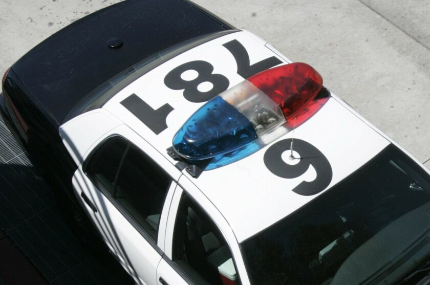 Overhead view of a police car, looking down at the light bar
