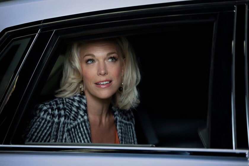 """Actress Hannah Waddingham peers out a car window in a scene from the Apple TV+ comedy """"Ted Lasso."""""""