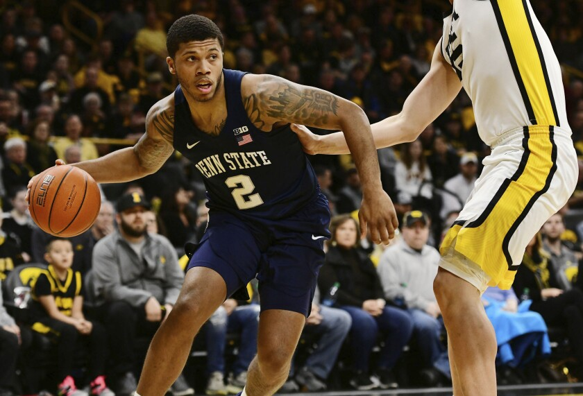 """FILE - Penn State's Myles Dread (2) tries to drive past Iowa's Luka Garza during the first half of an NCAA college basketball game in Iowa City, Iowa, in this Saturday, Feb. 29, 2020, file photo. """"A lot of kids that are coming from places that don't have a lot of money, their families aren't very well off, they're not going to go to a school where they're going to have to struggle even more,"""" Penn State basketball player Myles Dread said. """"They're going to go somewhere where they can help not only support themselves and live comfortably, but help support their family."""" Dread said he has tried to lobby Pennsylvania officials to support measures that could help athletes. The state does have pending legislation on the topic but hasn't passed anything yet. (AP Photo/Cliff Jette, File)"""