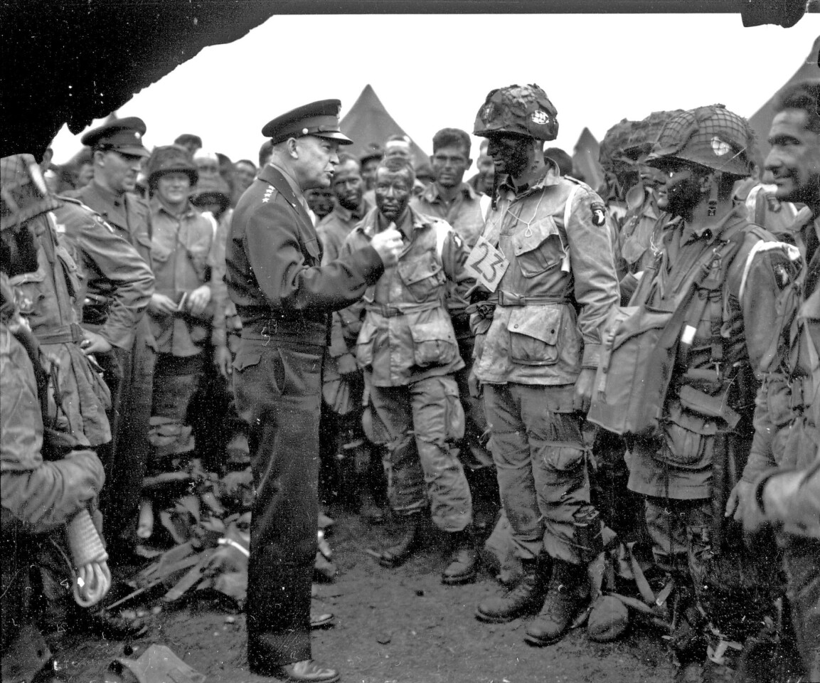 U.S. Gen. Dwight D. Eisenhower, the supreme Allied commander, talks with men of the 101st Airborne Division at the Royal Air Force base in Greenham Common, England on June 6, 1944, before they joined the D-Day invasion.