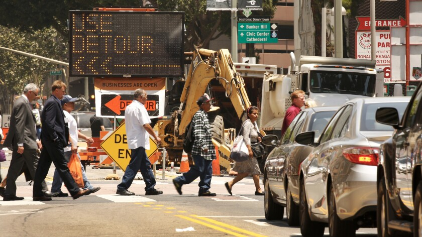 Signs warn of road closure at intersection of West 3rd Street and South Broadway in downtown Los Angeles, where a surge in construction has sparked what residents and commuters say is some of the worst traffic they can remember.