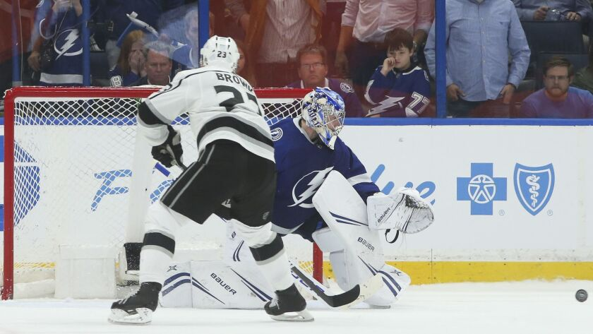 Tampa Bay goaltender Andrei Vasilevskiy stops a shot by the Kings' Dustin Brown (23) as the Lightning get a shootout win on Monday night.