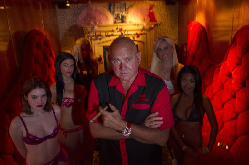 Dennis Hof, owner of the Moonlight Bunny Ranch, center, stands for a photograph inside the Moonlight Bunny Ranch in Carson City, Nevada, U.S., on Tuesday, Aug. 20, 2013. Hof is running for state legislature as a coalition of groups pushes for a ban on brothels.