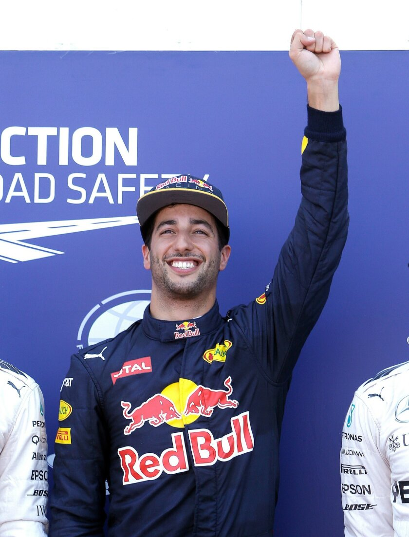 Red Bull driver Daniel Ricciardo of Australia, reacts after winning the qualification, at the Monaco racetrack, in Monaco, Saturday, May 28 2016. The Formula one race will be held on Sunday. (AP Photo/Claude Paris)