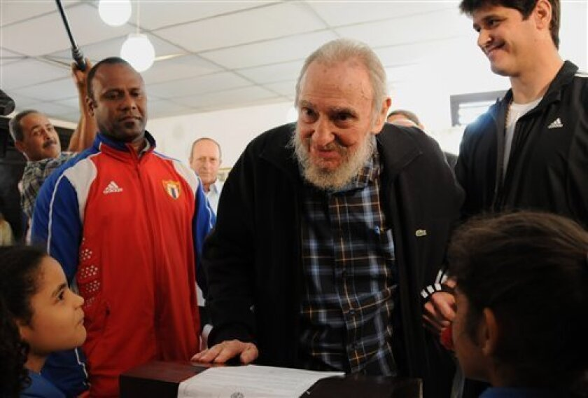 Cuba's leader Fidel Castro votes at a polling station during parliament elections in Havana, Cuba, Sunday, Feb. 3, 2013. Castro, who appears in public only occasionally, was among more than 8 million islanders eligible to vote and approve 612 members of the National Assembly and over 1,600 provinci
