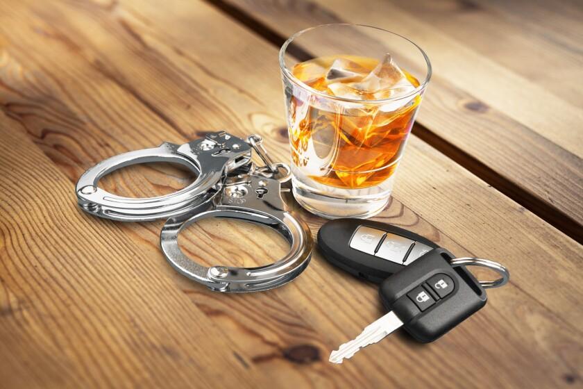 alcohol, car keys, handcuffs