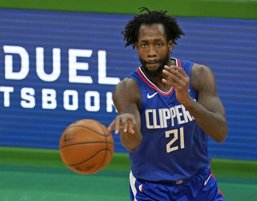 Clippers guard Patrick Beverley passes the ball against the Boston Celtics.