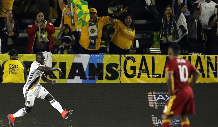 Galaxy midfielder Emmanuel Boateng, left, celebrates after scoring a goal as Real Salt Lake forward Joao Plata (10) watches during the first half of an MLS playoff game on Oct. 26.