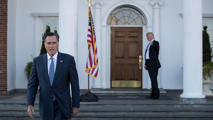 Mitt Romney gets a thumbs-up sendoff from President-elect Donald Trump after they met at Trump International Golf Club in New Jersey.
