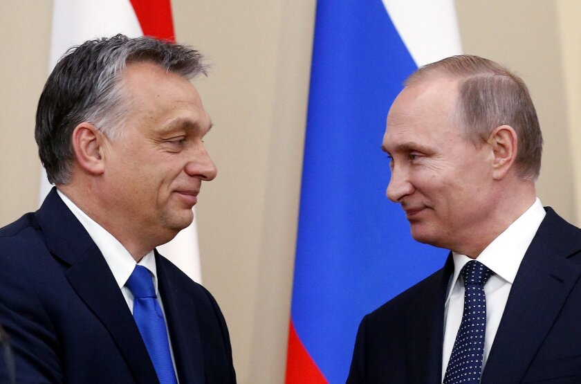 Russian President Vladimir Putin, right, and Hungarian Prime Minister Viktor Orban attend a joint news conference following their talks in the Novo-Ogaryovo residence outside Moscow, Russia, Wednesday, Feb. 17, 2016. Hungary's Prime Minister Viktor Orban says on a visit to Russia that the influx of