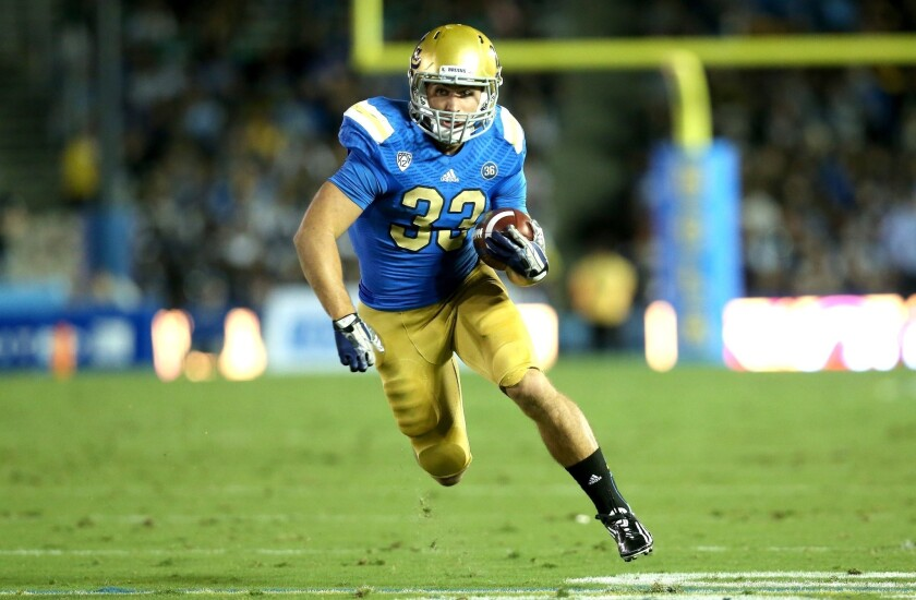UCLA running back Steven Manfro stands out in strong crowd