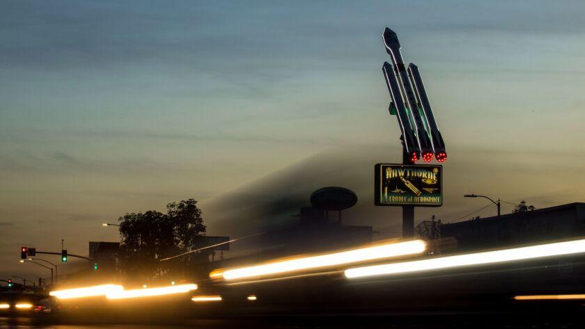 HAWTHORNE, CA - DECEMBER 07: Cars seemingly streak by in long exposure along Hawthorne Boulevard wh