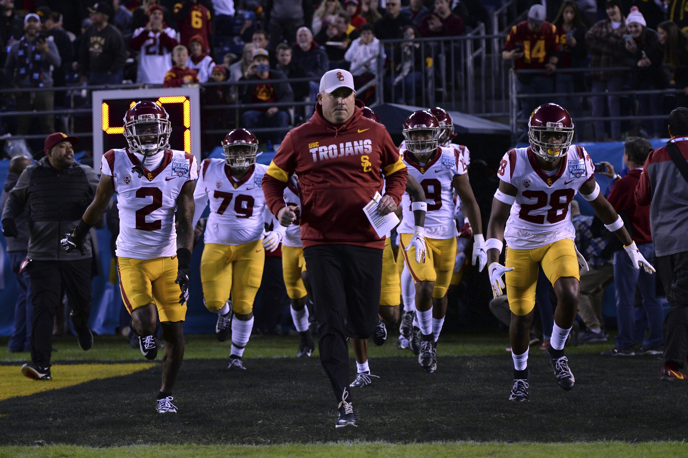 USC coach Clay Helton leads the Trojans onto the field for the Holiday Bowl against Iowa on Dec. 27 in San Diego.