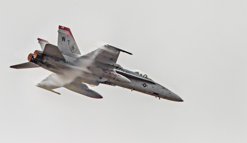 An F-18 jet flies during preview day for the MCAS Miramar Airshow in 2019 in San Diego