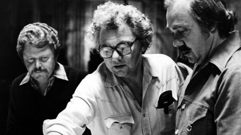Cinematographer Gordon Willis, center, outlines the lighting for a scene in MGM's 'Pennies from Heaven' in 1981.