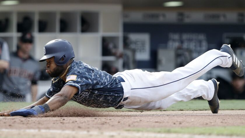 San Diego Padres' Manuel Margot slides into home safely after Arizona Diamondbacks catcher John Ryan