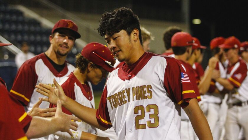 Teammates cheer Torrey Pines' Kevin Sim after his game-winning hit late Saturday night at USD's Fowler Park.