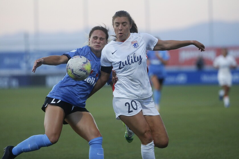 Chicago Red Stars' Bianca St. Georges, left, and Reign's Sofia Huerta (20) battle for the ball during the first half of an NWSL Challenge Cup soccer match at Zions Bank Stadium, Saturday, July 18, 2020, in Herriman, Utah. (AP Photo/Rick Bowmer)