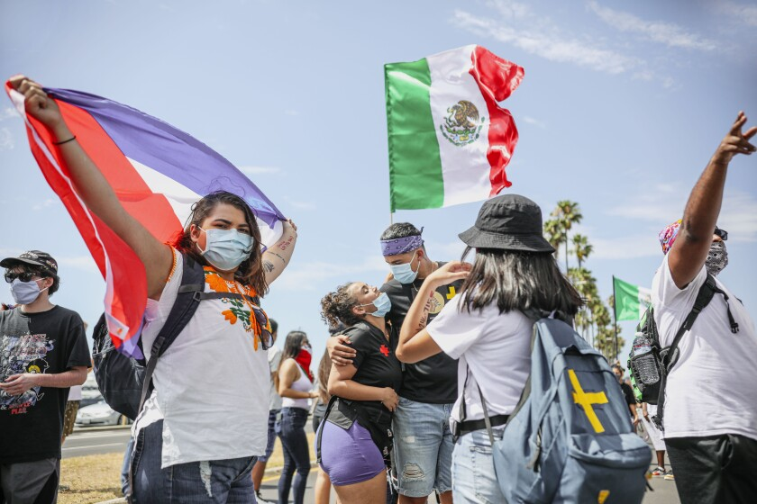 Abolish ICE and Black Lives Matter demonstrators gather at San Diego's Waterfront Park on Saturday, July 11, 2020.