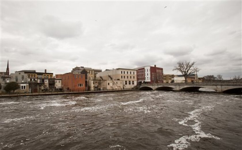 This photo taken April 6, 2011 shows the Rock River in downtown Janesville, Wis. A solid majority of Janesville voters helped elect Rep. Paul Ryan, R-Wis., seven times and watched with pride as he became one of Congress' leading authorities on the federal budget. But this week, admiration has been