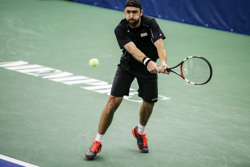 Benjamin Becker of Germany returns the ball against John Millman during the fourth day of the Memphis Open tennis tournament in Memphis, Tenn., Thursday, Feb. 11, 2016. (Brad Vest/The Commercial Appeal via AP) MANDATORY CREDIT