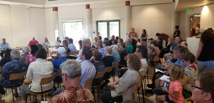 The community room at Point Loma Library is packed during the Peninsula Community Planning Board's Special Meeting on Aug. 28, when community members offered feedback in regards to possible development at the Famosa Canyon.