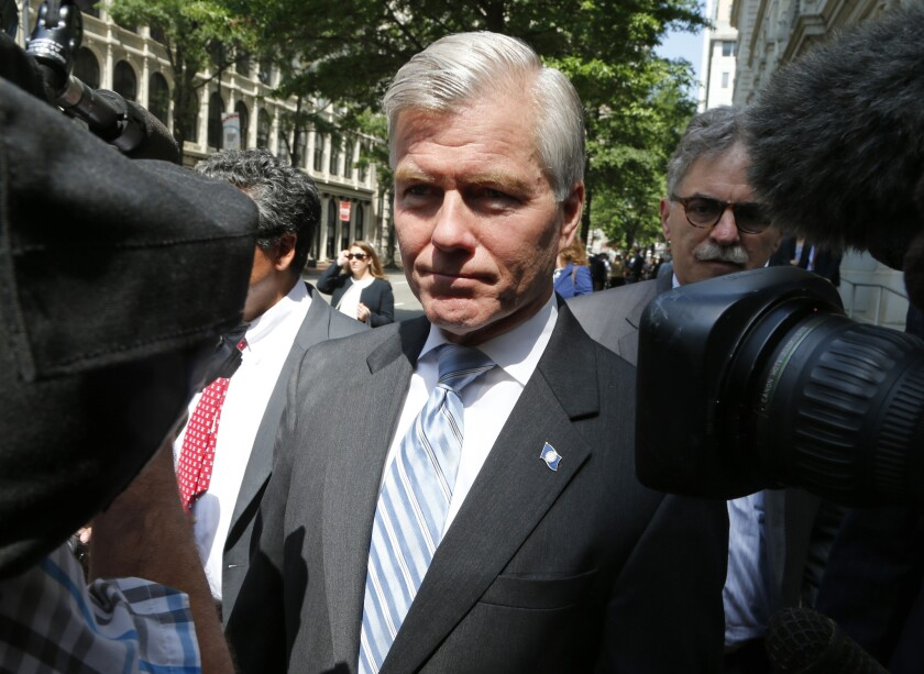 Former Virginia Gov. Bob McDonnell navigates a group of cameras as he leaves the 4th U.S. Circuit Court of Appeals after a hearing the appeal of his corruption conviction in Richmond, Va., last May.