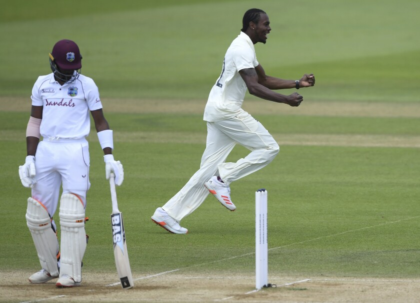 England's Jofra Archer, right, celebrates the dismissal of West Indies' Shamarh Brooks, left, during the fifth day of the first cricket Test match between England and West Indies, at the Ageas Bowl in Southampton, England, Sunday, July 12, 2020. (Mike Hewitt/Pool via AP)