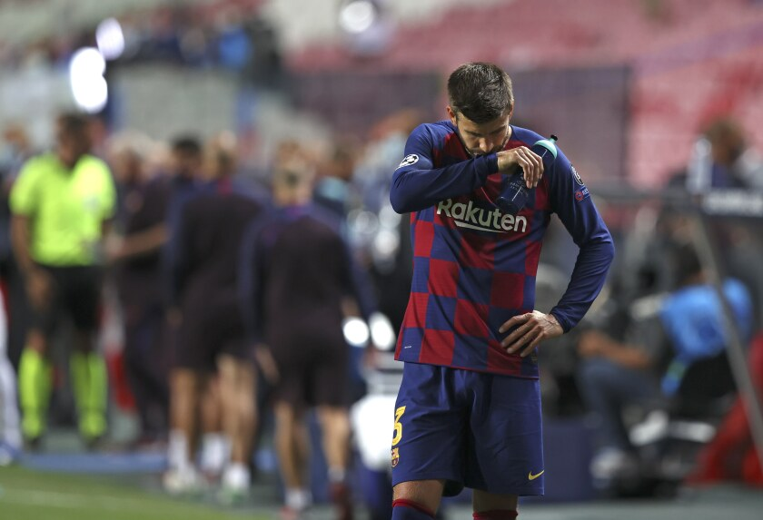 Barcelona's Gerard Pique reacts after the the Champions League quarterfinal soccer match between Barcelona and Bayern Munich in Lisbon, Portugal, Friday, Aug. 14, 2020. Bayern won the match 8-2. (Rafael Marchante/Pool via AP)