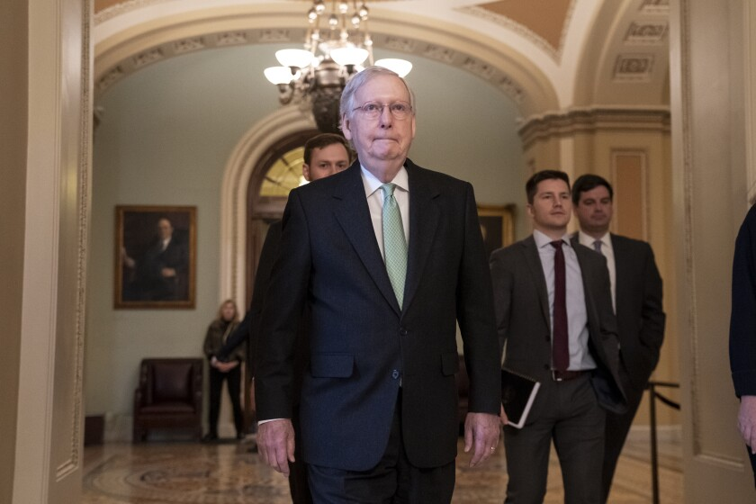 Senate Majority Leader Mitch McConnell (R-Ky.) leaves the chamber after criticizing the House Democrats' effort to impeach President Trump on Tuesday.