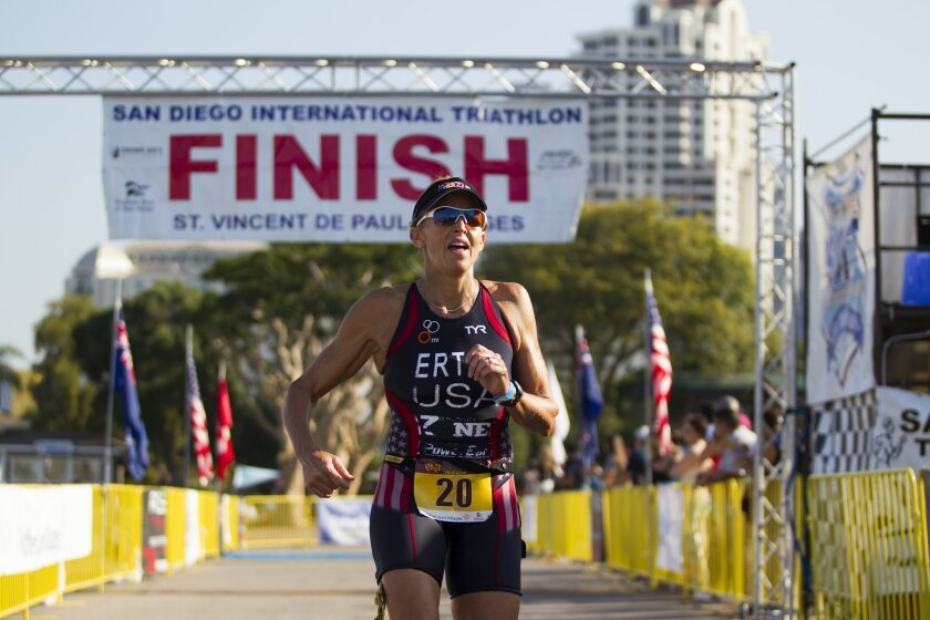 The San Diego International Triathlon started at Spanish Landing Park with a 1k swim, followed by a 30k bike ride to Cabrillo Monument and back, and finished with a 10k run to the Embarcadero. Julie Ertel crosses the finish line to finish first in the Elite/Pros women's division with a time of 01:37:53. Chadd Cady for the San Diego Union-Tribune