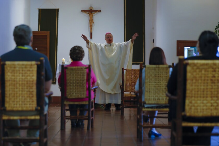 Bishop John Dolan celebrates Mass at Father Joe's Villages.