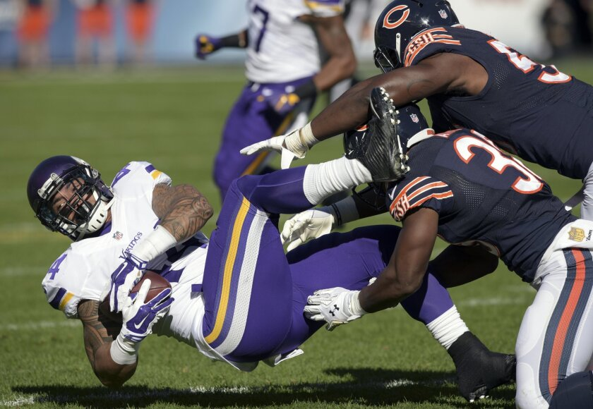 Minnesota Vikings running back Matt Asiata (44) is taken down by Chicago Bears free safety Adrian Amos (38) and inside linebacker Christian Jones (59) during an NFL football game in Chicago, Sunday, Nov. 1, 2015. (Mark Black/Daily Herald via AP) MANDATORY CREDIT; MAGAZINES OUT