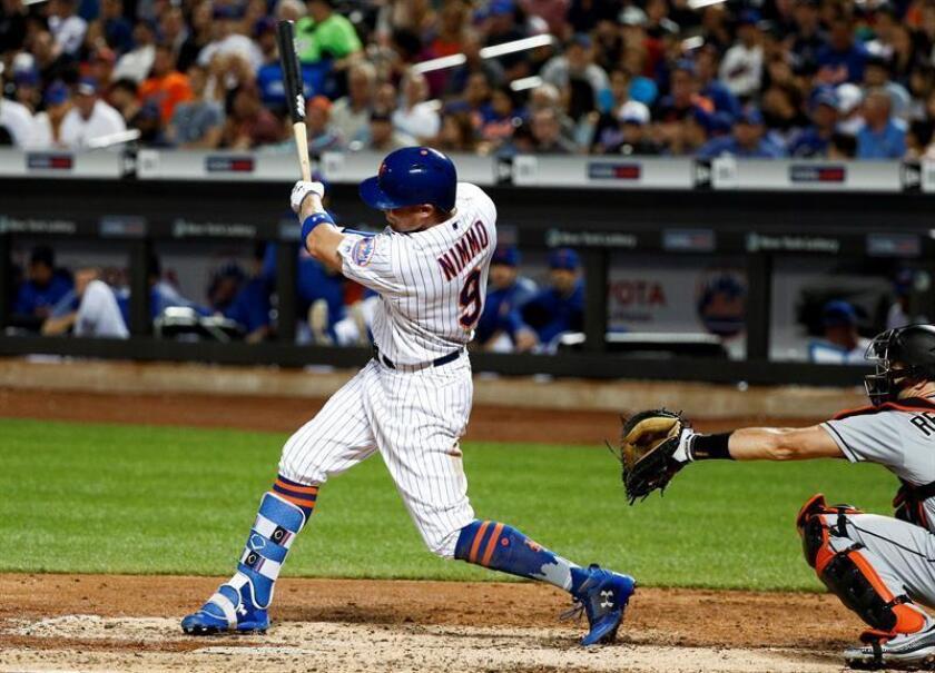En la imagen, el jugador Brandon Nimmo (i) de los Mets. EFE/Archivo