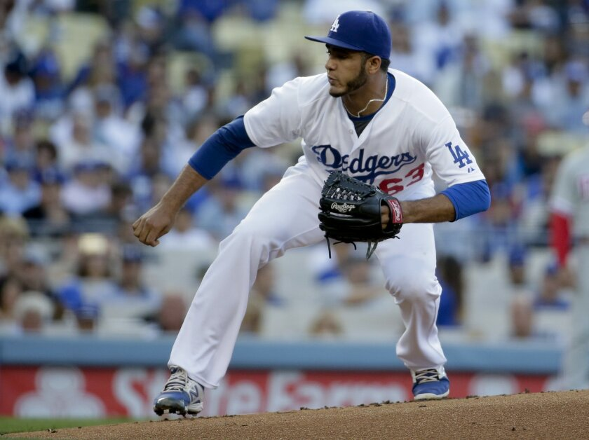 Los Angeles Dodgers starting pitcher Yimi Garcia throws against the Philadelphia Phillies during the first inning of a baseball game in Los Angeles, Monday, July 6, 2015. (AP Photo/Chris Carlson)