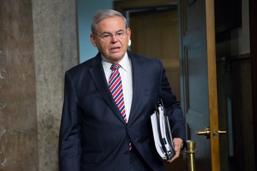 Sen. Bob Menendez arrives for a Senate Foreign Relations Committee hearing on the Iran nuclear agreement on July 23, 2015.