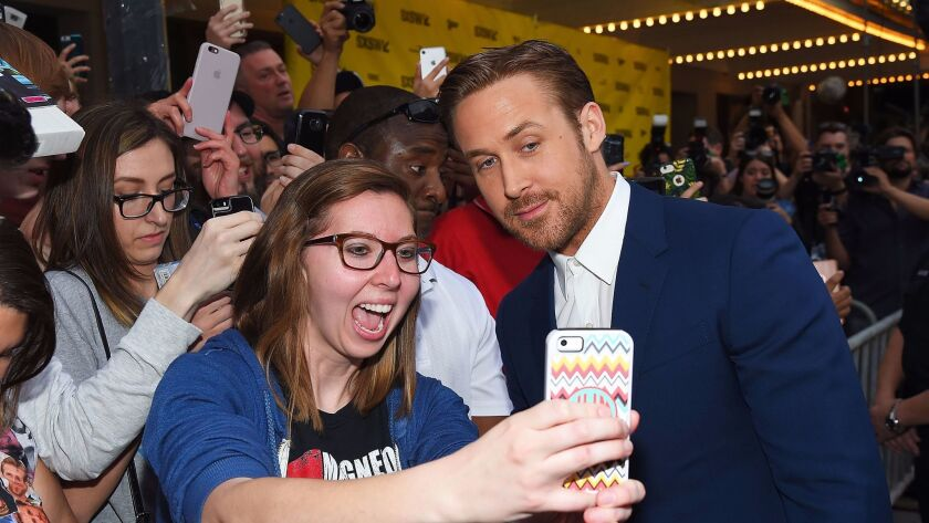 """Selfie time: Ryan Gosling works the crowd at South by Southwest during the """"Song to Song"""" premiere."""