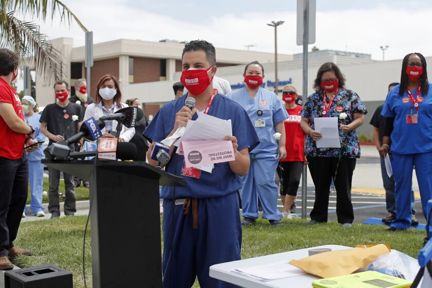 Josh Jesus, a CT Tech, speaks during a press conference outside Fountain Valley Regional Hospital's emergency room Thursday.