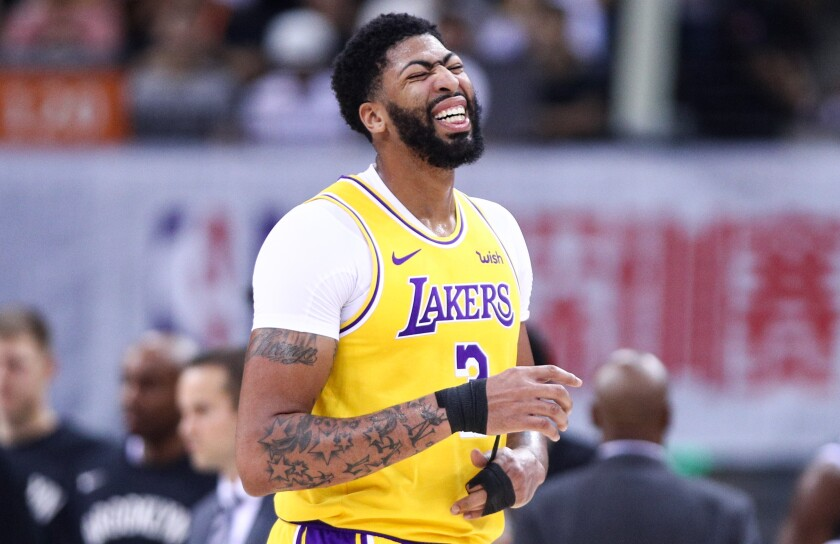 Lakers forward Anthony Davis grimaces after sustaining a thumb injury during the first half Saturday.
