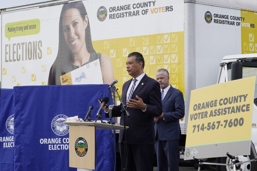California Secretary of State Alex Padilla, left, and Orange County Registrar of Voters Neal Kelley hold a news conference