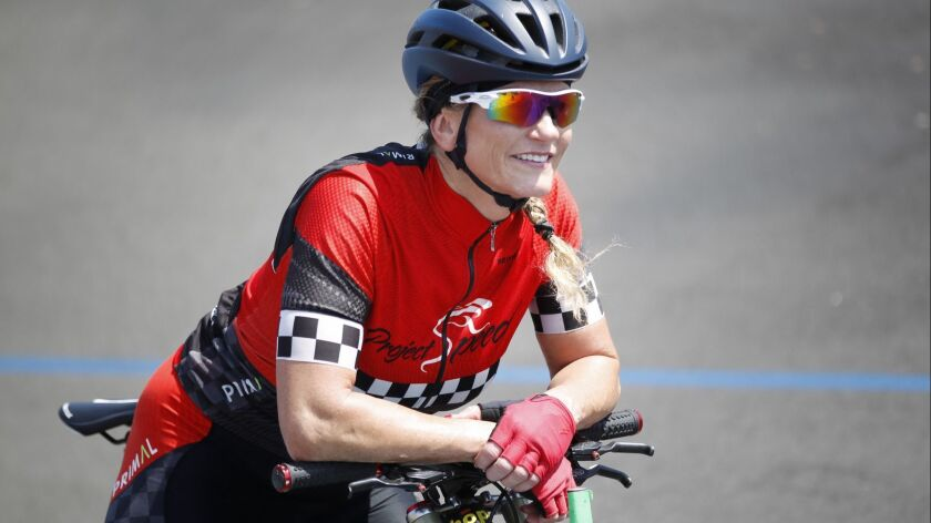 Taking a break during a recent workout at the San Diego Velodrome, Denise Mueller-Korenek holds the women's world paced bicycle speed record of 147.7 mph set in 2016. On Sept. 15, she hopes to break the men's world record of 167 mph.