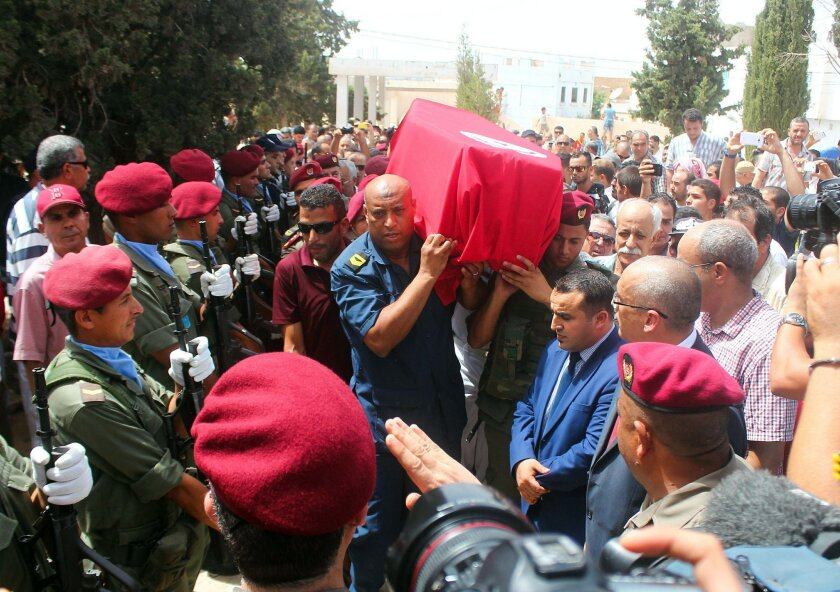 Family, friends and officers carry the Tunisian flag-draped coffin of the head of the pediatric service at the Tunis military hospital, Col. Fathi Bayoudh, one of the victims killed Tuesday at the blasts in Istanbul's Ataturk airport, during his funeral in Ksour Essaf, southern Tunisia, Friday, Jul
