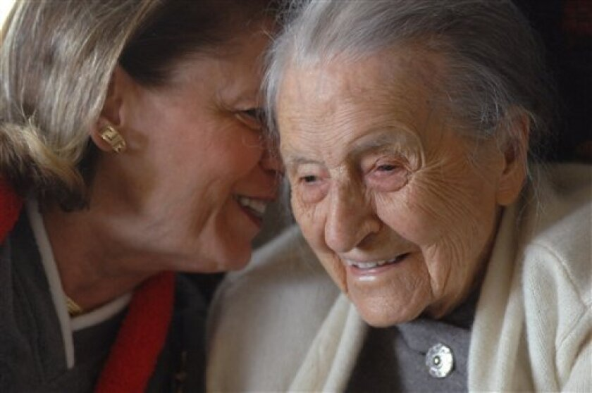 In a 2008 photo, Dr. Leila Denmark, right, listens to her grand niece Jackie Bennett as she celebrates her 110th birthday, in Athens, Ga. Family members say Denmark, who was the world's oldest practicing physician when she retired at age 103, died Sunday, April 1, 2012 in Athens, Ga. She was 114. . (AP Photo/Athens Banner Herald, Trevor Frey) MANDATORY CREDIT MAGS OUT TV OUT