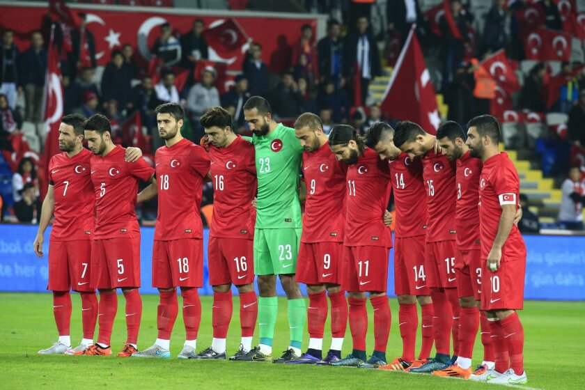 Turkey's players observe a minute of silence to honour the victims of the Paris attacks prior to an international friendly soccer match against Greece, in Istanbul, Tuesday Nov. 17, 2015. (AP Photo/Lefteris Pitarakis)