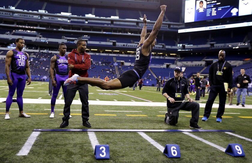 Connecticut defensive back Byron Jones takes a leap at the NFL scouting combine Monday in Indianapolis.