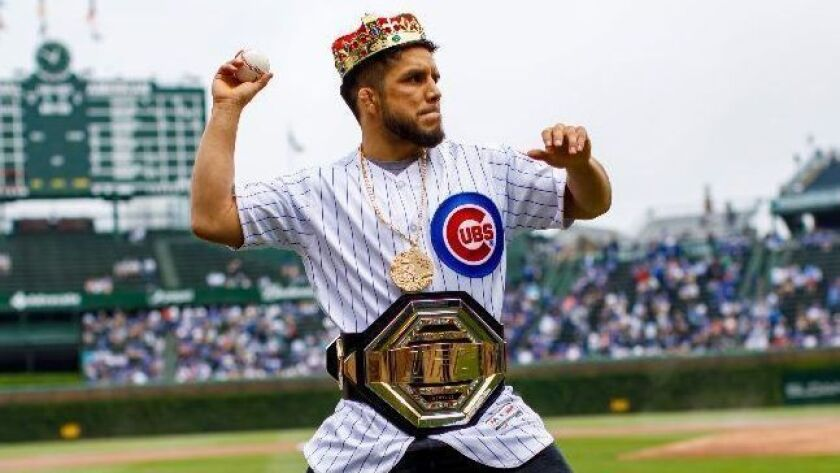 Henry Cejudo throws out the first pitch before the Chicago Cubs game on Thursday.