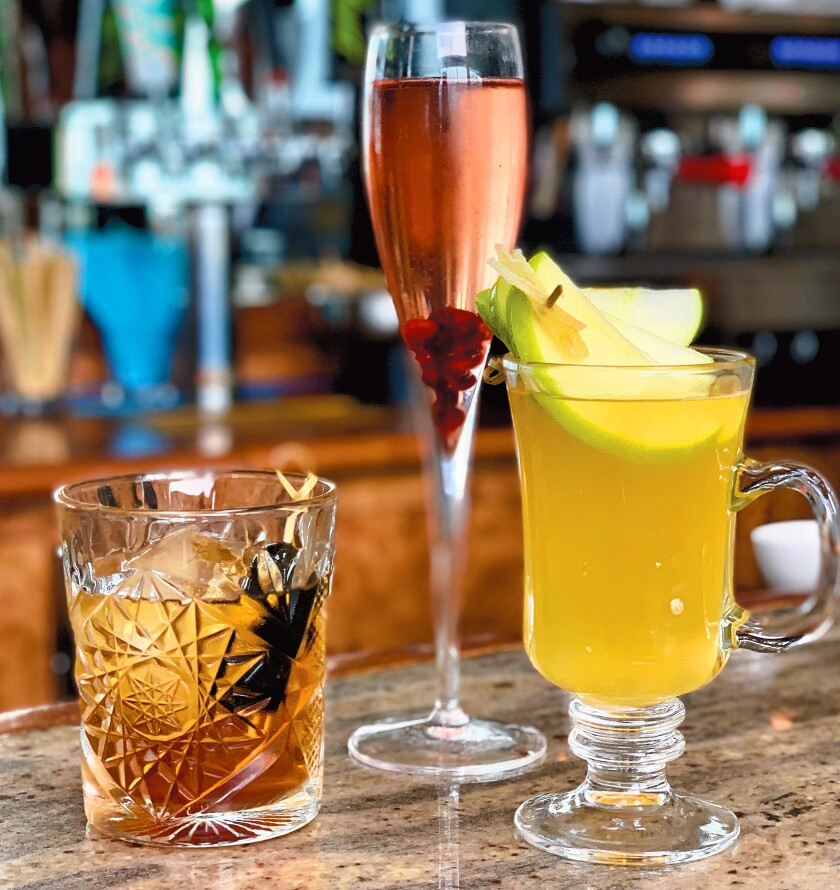 Some of the holiday drinks available at The Marine Room in La Jolla include the PB Old Fashioned, Holiday Sparkler, and Warm Gingered Apple.