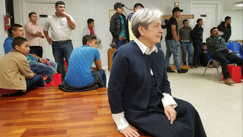Sister Norma Pimentel surrounded by Central American migrant families at a shelter she runs in the b