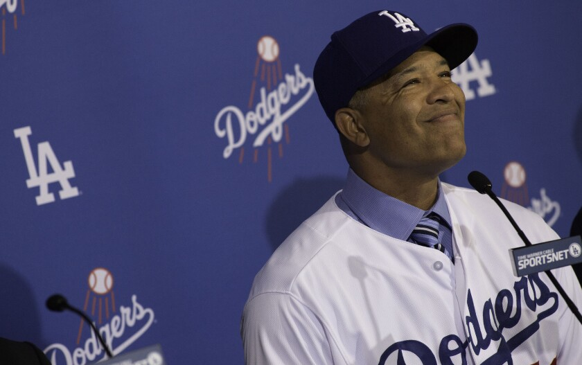 Dave Roberts is introduced as the new Dodgers manager during a news conference at Dodger Stadium.